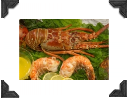 spiny lobster on a bed of lettuce with shrimp, drawn butter and lemon