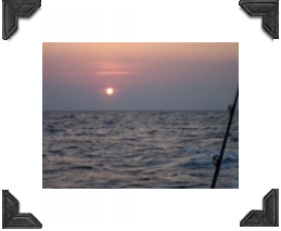 sunrise from gulf of mexico fishing rod in view, no land in sight